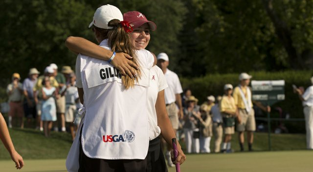 Kristen Gillman receives a hug from her caddie/sister Emily after winning the U.S. Women's Amateur on Sunday.