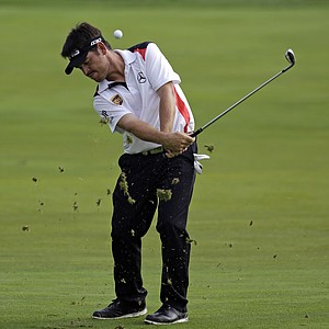 Louis Oosthuizen hits from the fairway on the seventh hole during the final round of the PGA Championship.