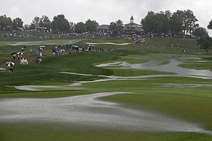 Rain water pools up on the first hole during the final round of the PGA Championship at Valhalla.