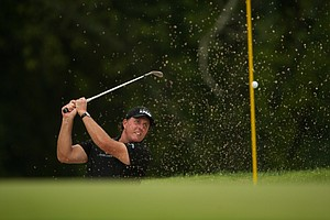Phil Mickelson hits a shot out of the bunker on No. 9 during the final round of the PGA Championship at Valhalla.
