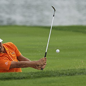Rickie Fowler hits out of the bunker on the seventh hole during the final round of the PGA Championship.