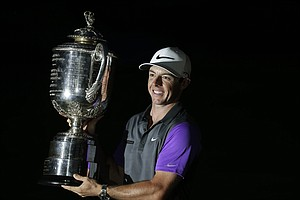 Rory McIlroy holds up the Wanamaker Trophy after winning the PGA Championship at Valhalla.