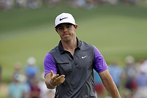 Rory McIlroy reacts to his missed putt on the first hole during the final round of the PGA Championship.