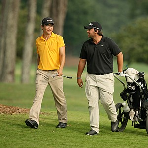 Byron Meth, left, and Mario Galiano, right, walk up No. 18 on Highlands course during the 2014 U.S. Amateur.