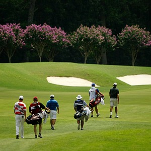 A group walks down the 10th fairway on Highlands Course at the 2014 U.S. Amateur at the Atlanta Athletic Club.