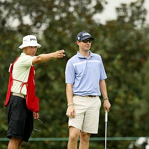 John Sawin chat with his caddie at the 2014 U.S. Amateur at the Atlanta Athletic Club.