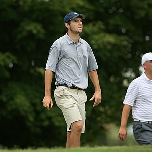 Scottie Scheffler walks down the 10th tee box at the 2014 U.S. Amateur at the Atlanta Athletic Club.