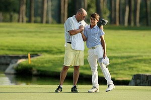 Will Thomson, the youngest ever to qualify for the 2014 U.S. Amateur, with his coach/caddie at the Atlanta Athletic Club.