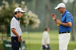 The youngest competitor in the field, Will Thomson with his coach, Joe Lusardi after round one of stroke-play at the 2014 U.S. Amateur at the Atlanta Athletic Club.