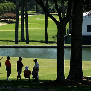 immy Mullen, far left, of England hits a shot at No. 18 during the round of 64 at the 2014 U.S. Amateur at the Atlanta Athletic Club.