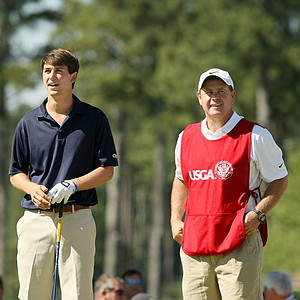 Ollie Schniederjans with his caddie/coach during the round of 64 at the 2014 U.S. Amateur at the Atlanta Athletic Club.