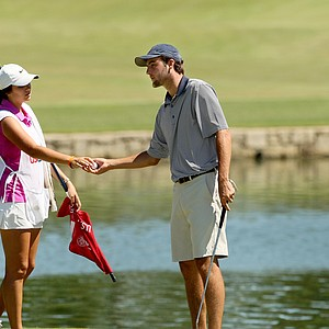 Scottie Scheffler with his sister/caddie, Callie, during the round of 64 at the 2014 U.S. Amateur at the Atlanta Athletic Club. Scheffler lost to Corey Conners.