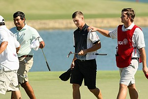 Mookie DeMoss, center, lost to Roman Robledo, 1-up, during the round of 64 at the 2014 U.S. Amateur at the Atlanta Athletic Club.