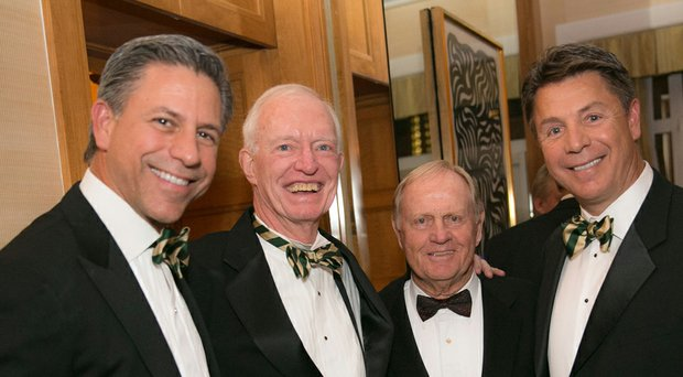 Evans Scholars Foundation senior vice president of foundation advancement Jim Moore, second from left, with Jack Nicklaus and Evans scholars George (left) and Geoff Solich.
