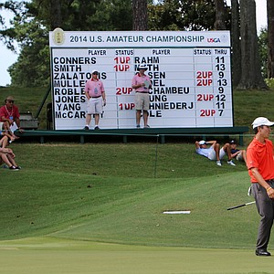 Byron Meth reacts as his putt slides by the hole at No. 14 during the round of 16 at the 2014 U.S. Amateur at the Atlanta Athletic Club.