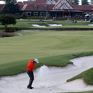 Byron Meth hits out of a fairway bunker at No. 18 during the round of 16 at the 2014 U.S. Amateur at the Atlanta Athletic Club.