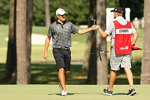 Corey Conners with his caddie, Taylor Pendrith, during the round of 16 at the 2014 U.S. Amateur at the Atlanta Athletic Club.