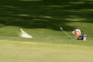 Jimmy Mullen hits out of a bunker during the round of 16 at the 2014 U.S. Amateur at the Atlanta Athletic Club.
