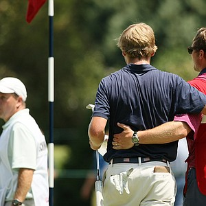 Sam Burns and his caddie leave the 2nd hold after losing in extra holes to Ollie Schniederjans during the round of 32 at the 2014 U.S. Amateur at the Atlanta Athletic Club.--(Golfweek/Tracy Wilcox)