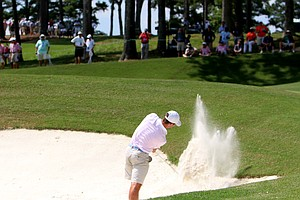 Denny McCarthy blasts out of a bunker enroute to defeating Roman Robledo during the quarterfinals at the 2014 U.S. Amateur at the Atlanta Athletic Club.