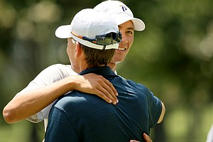 Frederick Wedel gets a hug from his Pepperdine coach, Michael Beard, during the quarterfinals at the 2014 U.S. Amateur at the Atlanta Athletic Club.