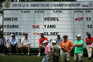 Spectators watch the action at No. 16 during the quarterfinals at the 2014 U.S. Amateur at the Atlanta Athletic Club.
