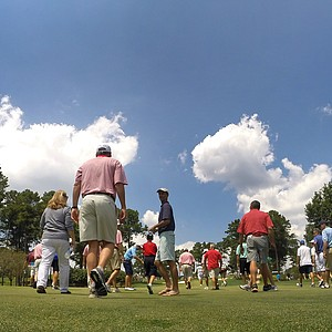 Galleries walk behind the players during the quarterfinals at the 2014 U.S. Amateur.