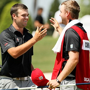 Corey Conners celebrates with his caddie Taylor Pendrith after defeating Denny McCarthy during the semifinals at the 2014 U.S. Amateur at the Atlanta Athletic Club.