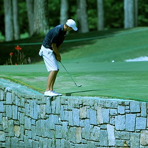 Frederick Wedel hits his shot from the rock wall at No. 17 during the semifinals at the 2014 U.S. Amateur at the Atlanta Athletic Club.