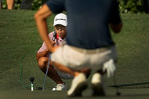Gunn Yang lines up his putt at No. 9 during the semifinals at the 2014 U.S. Amateur at the Atlanta Athletic Club.