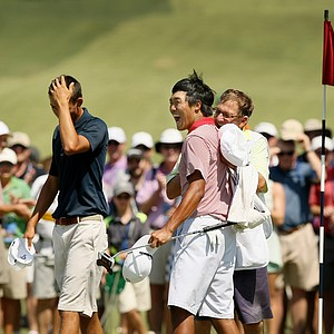 Gunn Yang reacts to defeating Frederick Wedel during the semifinals at the 2014 U.S. Amateur at the Atlanta Athletic Club.