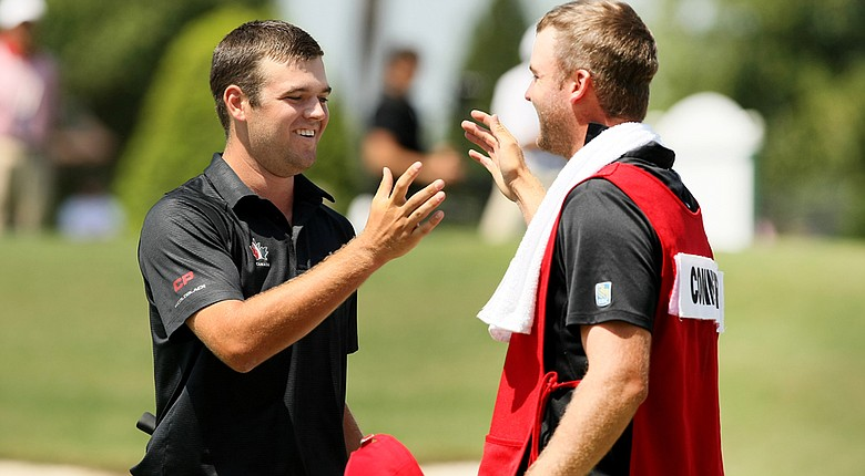 Corey Conners (left) celebrates his U.S. Amateur semifinals victory with his caddie Taylor Pendrith.