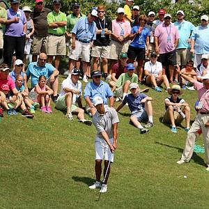 Gunn Yang hits a down hill shot at No. 16 during the finals at the 2014 U.S. Amateur at the Atlanta Athletic Club.