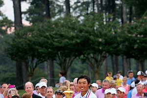 Gunn Yang with the Havemeyer Trophy after the finals of the 2014 U.S. Amateur at the Atlanta Athletic Club.