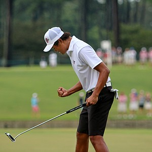 Gunn Yang pumps his fist after winning the 2014 U.S. Amateur at the Atlanta Athletic Club.