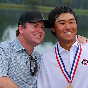San Diego State head coach Ryan Donovan poses with his player and newly minted champion, Gunn Yang, at the 2014 U.S. Amateur at the Atlanta Athletic Club.