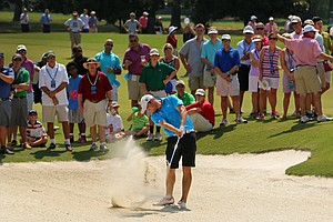Corey Conners hits a bunker shot at No. 14 during the finals at the 2014 U.S. Amateur at the Atlanta Athletic Club.