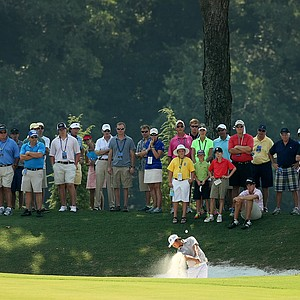 Gunn Yang hits from a fairway bunker at No. 13 during the finals at the 2014 U.S. Amateur at the Atlanta Athletic Club.