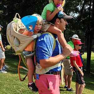 Justin Ricketts of Atlanta, GA with his kids, Sawyer and Elle, watch the finals at the 2014 U.S. Amateur at the Atlanta Athletic Club.