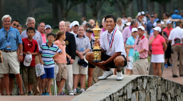 Gunn Yang poses with the Havemeyer Trophy after outlasting Corey Conners to win the 114th U.S. Amateur at Atlanta Athletic Club.