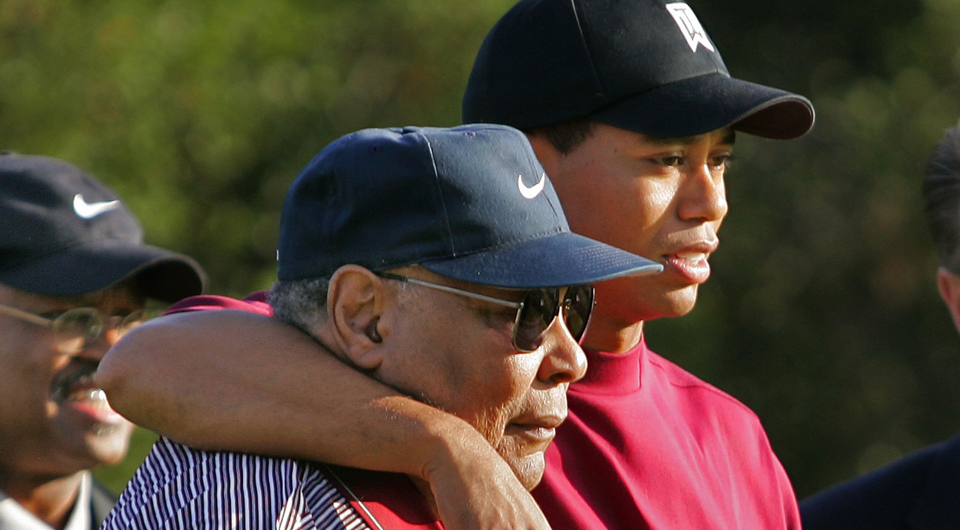 Tiger Woods with his dad, Earl, who taught him to be precise by pushing Tiger to use persimmon woods.