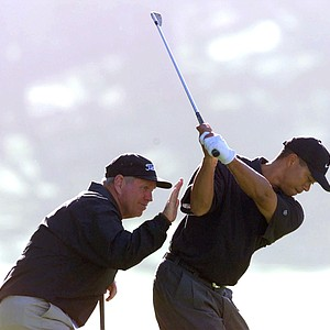 Butch Harmon works with Tiger Woods on his swing at the 2000 AT&T Pebble Beach National Pro-Am on PGA Tour.