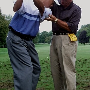 Butch Harmon works with Tiger Woods on his swing at the 1999 PGA Championship at Medinah.