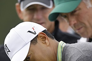 Hank Haney and caddie Steve Williams work with Tiger Woods at the 2009 Masters.