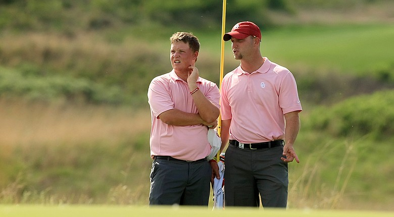 Oklahoma's Michael Gellerman (left) with head coach Ryan Hybl during the 2014 NCAA Championship.