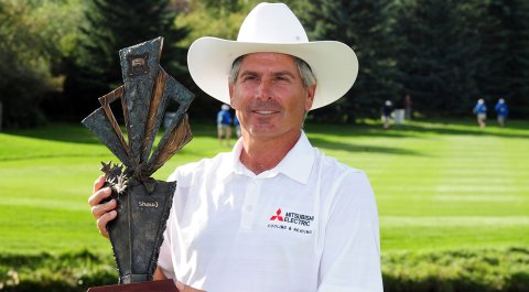 Fred Couples holds the trophy after winning the Shaw Charity Classic at the Canyon Meadows Golf & Country Club.