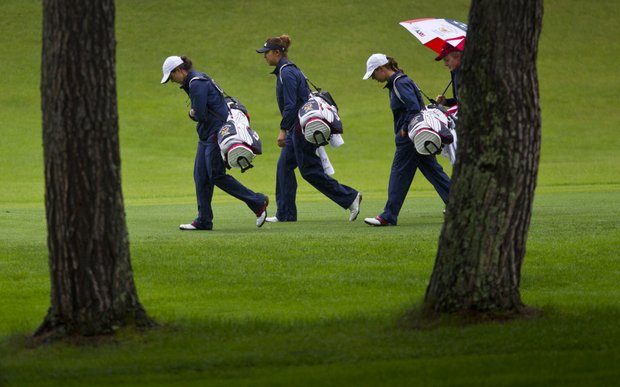 United States team members play a practice round in Japan.