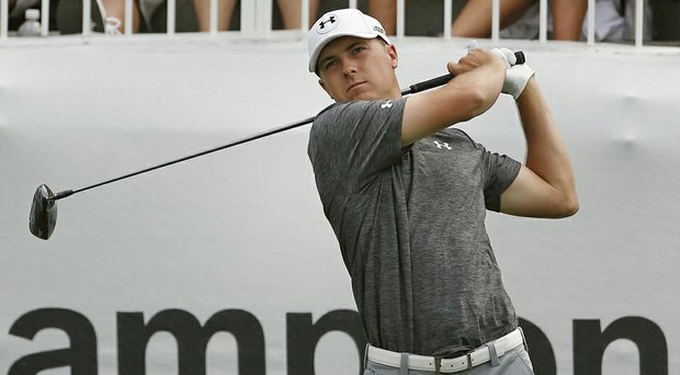 Jordan Spieth fired a 3-under 67 to share the first-round lead at the BMW Championship with Rory McIlroy and Gary Woodland.
