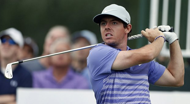 Rory McIlroy fired a 3-under 67 to share the first-round lead at the BMW Championship with Jordan Spieth and Gary Woodland.