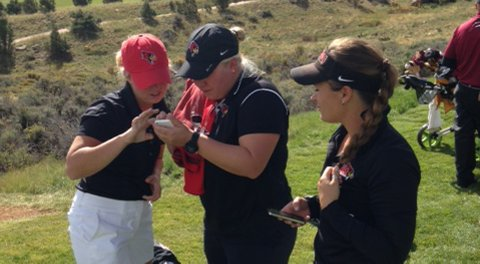 From left, Illinois State's Abby Luchtenburg, head coach Darby Sligh and Brianna Cooper setting up live scoring on the 10th tee at Red Sky Golf Club.